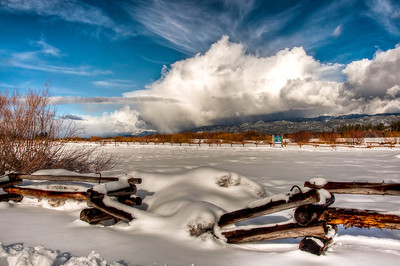 snow-field-fence-clouds