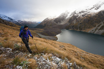 A female tramper following the Waiau Pass route above Lake Constance, Nelson Lakes National Park