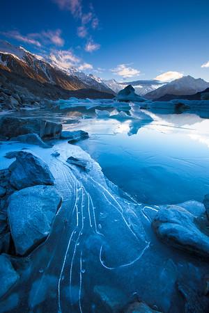Icebergs and Aoraki Mount Cook.  Tasman Glacier Terminal Lake. Aoraki Mount Cook National Park