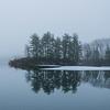 Misty Reflections of Nine Pines on Lake Tioroti.