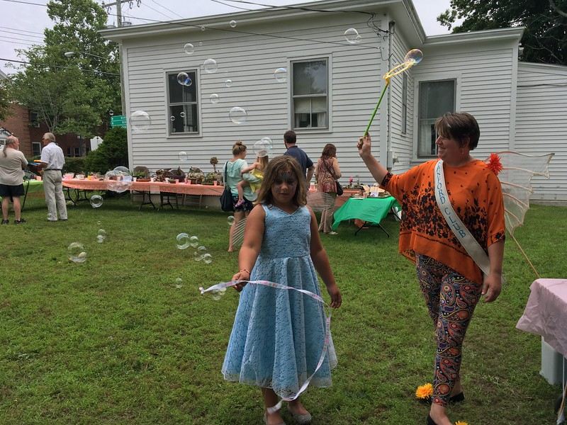 Chris and Olivia Claydon play with bubbles dressed in their fairy costumes