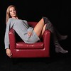 model in red chair with Duvetyne Black Fabric