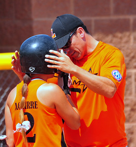 Lamar coach Eloy Orozco talks things over with Mireya  Aguiree during the 2014 Babe Ruth 16U Midwest Plains Regional played July 17-20 at Citizen's Field in Lamar.