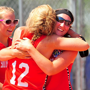 Southern Plains players Savanna Guyerman and Leah Osborn celebrate after beating defending regional champion Lamar, 7-6, to win the championship in the 2014 Babe Ruth Midwest Plains Regional Tournament that concluded on Sunday at Citizen's Field in Lamar. Southern Plains now advances to the 2014 16U World Series that runs on July 30 through August 5 in Pittsfield, Mass.