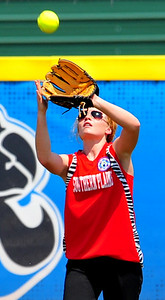 Southern Plains left fielder Miranda Mitchek makes a catch during action against Lamar on Saturday in the 2014 16U Midwest Plains Regional softball tournament that was held July 17-20 at Citizen's Field in Lamar. Southern Plains defeated Lamar, 11-7, in a semifinal game played on Saturday. The two teams meet again in the championship bracket on Sunday. Lamar pounded Southern Plains, 17-5, to force a second game for the regional champoinship. Southern Plains defeated Lamar, 7-6, to earn a trip to the 16U World Series to be played July 30 thru August 5 in Pittsfield, Mass.