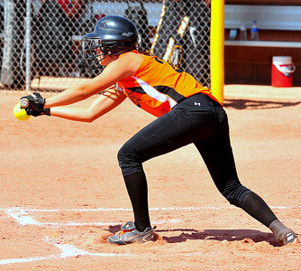 Lamar's Malea Orozco lays down a sacrifice bunt during the 2014 Babe Ruth 16U Midwest Plains Regional played July 17-20 at Citizen's Field in Lamar.