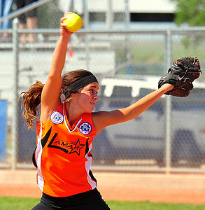 Lamar's Malea Orozco fires a pitch during the 2014 Babe Ruth 16U Midwest Plains Regional played July 17-20 at Citizen's Field in Lamar.