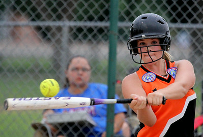 Lamar 14U's Lexi Koehn swings for a base hit during action in the 2014 Midwest Plains Regional softball tournament that was held over the weekend in Lamar. The Lamar 14U All-Star team placed second in the tournament.