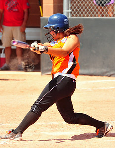 Lamar's Brittany Gonzales rips a base hit during action in the second game of the championship bracket against Southern Plains on Sunday in the Babe Ruth 16U Midwest Plains Regional. Gonzales had three hits including two doubles and an RBI single. Lamar, the defending regional champions, lost a heartbreaker 7-6 and a chance to advance to the 16U World Series for a second year in a row.