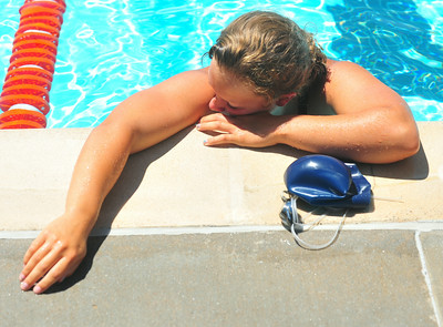 Lamarlins swimmer Taylor Wetz catches her breath after beating teammate Savannah Tice in close race in the Girls Open 100 Yard Freestyle during the Valley Championships held at the Lamar Swimming Pool over the weekend.