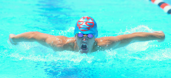 Lamarlins swimmer Jake Rogers competes in the Boys Open 100 Yard Butterfly during the Valley Championships held at the Lamar Swimming Pool over the weekend.