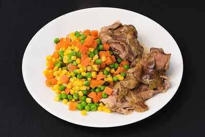 Slowly roasted lamb shoulder with vegetables