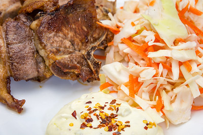 Lamb chops with coleslaw and wasabi sourcream close up