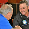 Guest Dave DeLong shakes hands with Don Reichert. Dave is PGA pro at Boundary Oaks golf course in Walnut Creek.