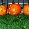 Three completed jack o'lanterns.