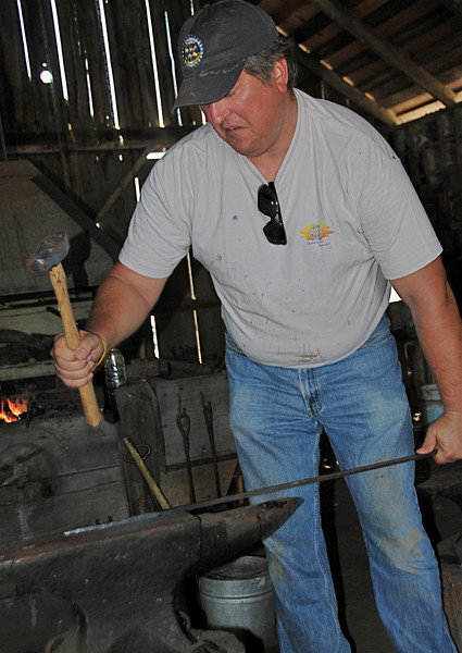 Worker-bee chores completed, Rich Shearer tried his hand at forging a nail in the ranch's blacksmith shop, a real, live, functioning blacksmith shop. Roughly four hours after this picture was taken, he had made a two-inch-long nail. Everyone applauded. Keep your day job, Rich.