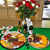 An arrangement of long-stemmed red roses added a touch a class to the buffet table, as did Champagne and plates of appetizers.