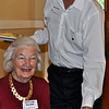 Brad Davis, another volunteer from Lamorinda Sunrise Rotary, serves guest Betty Ann Williams.