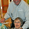 Volunteer Walt Nelson, longtime member of Lamorinda Sunrise Rotary, serves guest Elva Rust.