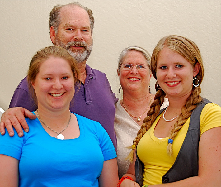 The Ware clan. Flanking their parents, Steve and Laurie Ware, are daughters Becky (left) and Katie Rose. Ware, the lone professionally trained jewelry designer in town, recently moved his store from the east side of Lafayette to 3645-A Mt. Diablo Blvd., between the post office and Trader Joe's. Official ribbon-cutting ceremonies were July 16.