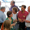 Steve Ware [purple shirt in background) chats with one of the invited guests who attended grand opening ceremonies at Ware Design's new location, 3645-A Mt. Diablo Blvd., Lafayette, between the post office and Trader Joe's. For many years Ware Designs was located on the east side of town at The Forge, corner of Mt. Diablo Blvd. and Brown Ave.