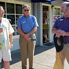Holding the official ceremonial ribbon-cutting scissors, Steve Ware chats with a couple of guests who attended the July 16 grand opening of his newly relocated store on Mt. Diablo Blvd. between the post office and Trader Joe's. For years, Ware Designs was located at The Forge on the east side of town.