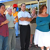Clustered under a portable awning to protect them from 95-degree heat, invited guests hear remarks from Lafayette resident Steve Ware. On July 16 he officially christened his newly relocated store, now doing business on Mt. Diablo Blvd. in Lafayette between the post office and Trader Joe's. Ware is the lone jewelry designer in town.