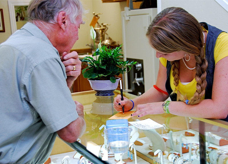 Katie Rose Ware completes an order form for a customer at Ware Designs jewelry store, recently relocated from the east side of Lafayette to new quarters on Mt. Diablo Blvd. between the post office and Trader Joe's. Her father, Steve Ware, is proprietor.