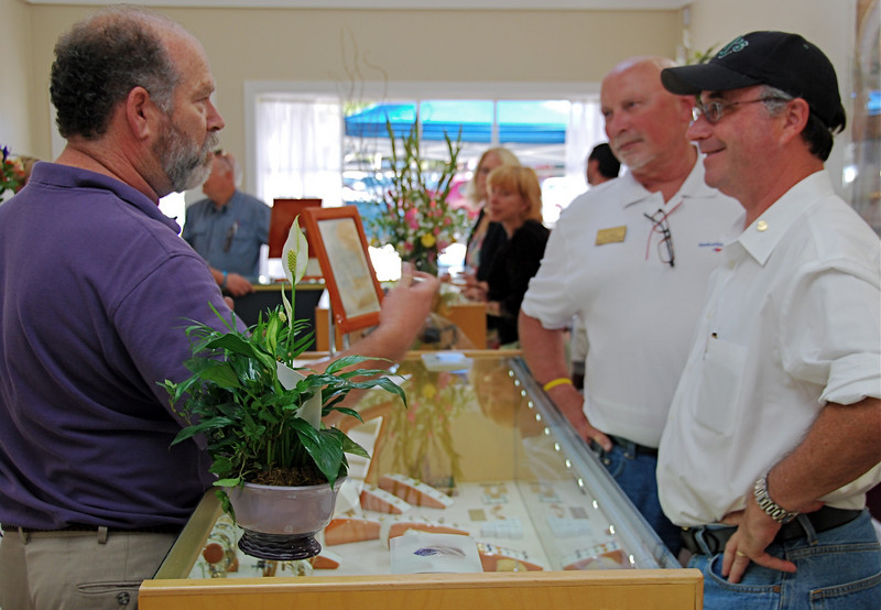 Proprietor Steve Ware chats with a couple of guests attending the store grand opening on July 16. Ware Designs relocated from one end of Mt. Diablo Blvd. to the other. The new address is 3645-A MDB, where Contra Costa Stationers conducted business for years, between the post office and Trader Joe's.