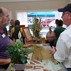 Steve Ware (left), owner of Ware Designs jewelry store, chats with a guest who attended official ribbon-cutting ceremonies on July 16 at the relocated store, now at 3645-A Mt. Diablo Blvd., between the post office and Trader Joe's.