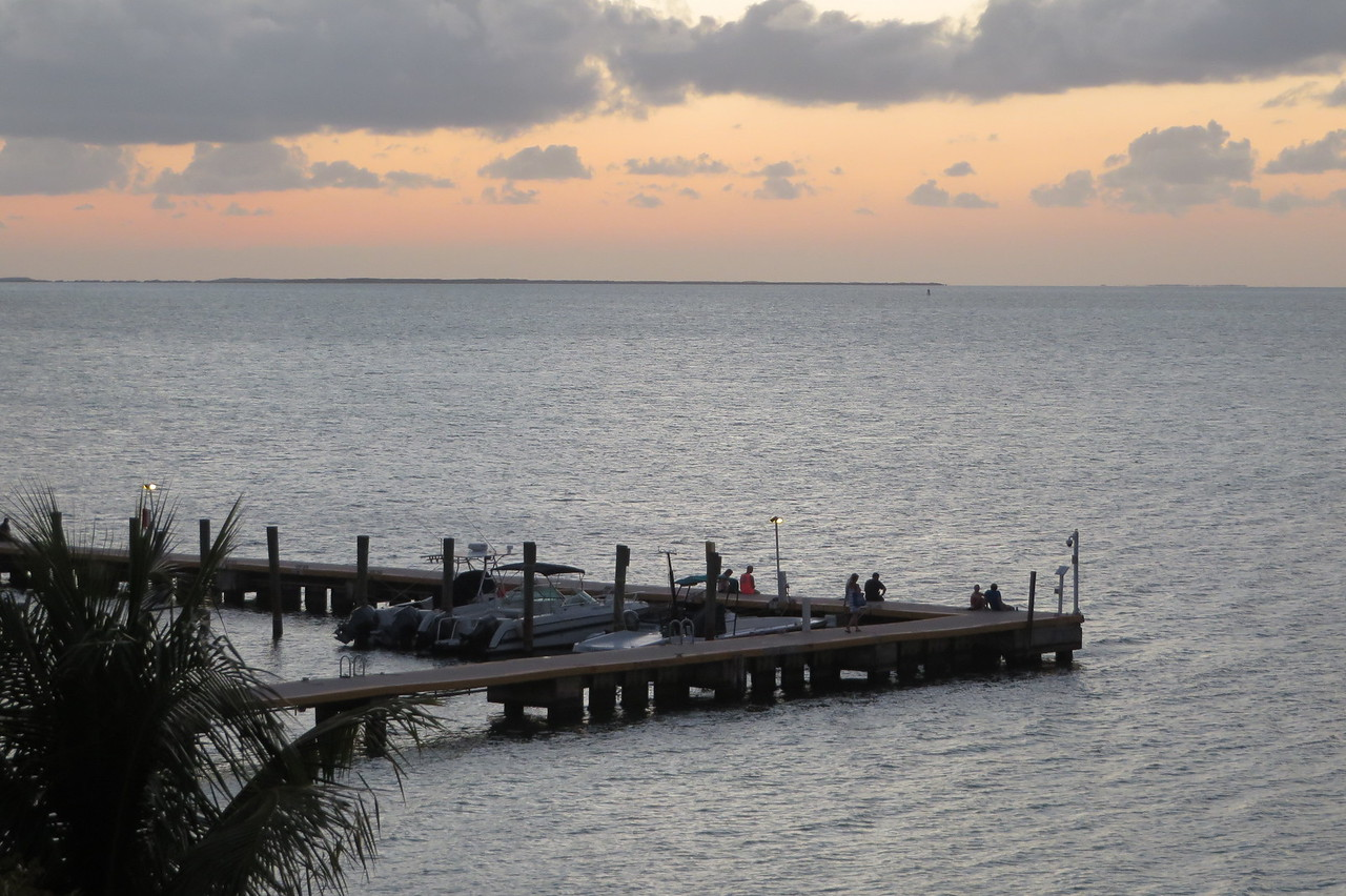 Others gather on the dock to enjoy the sunset and look for manatees