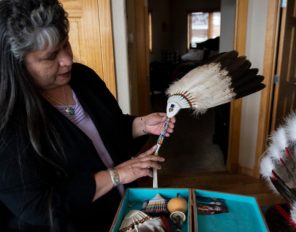 . Jacqueline White displays a bald eagle fan used by Native Americans to waft the smoke onto their bodies during spiritual ceremonies. (Photo by Tyler Pialet/Trail-Gazette)