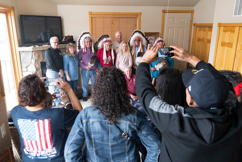 Following a spiritual ceremony in one of the rooms at Mary's Lake Lodge, Mayor Todd Jirsa and others pose with the Native American elders who blessed the land. <br /> (Photo by Tyler Pialet/Trail-Gazette)