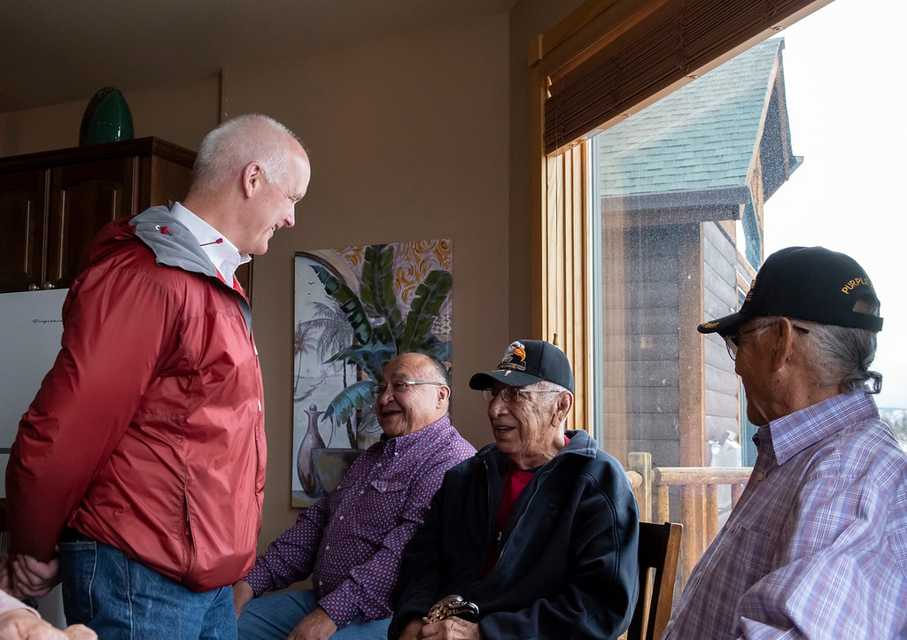 . Estes Park Mayor Todd Jirsa talks with Arapahoe Tribe elders. From left to right: Jirsa, Patrick Moss, Nelson White and Crawford white.  (Photo by Tyler Pialet/Trail-Gazette)