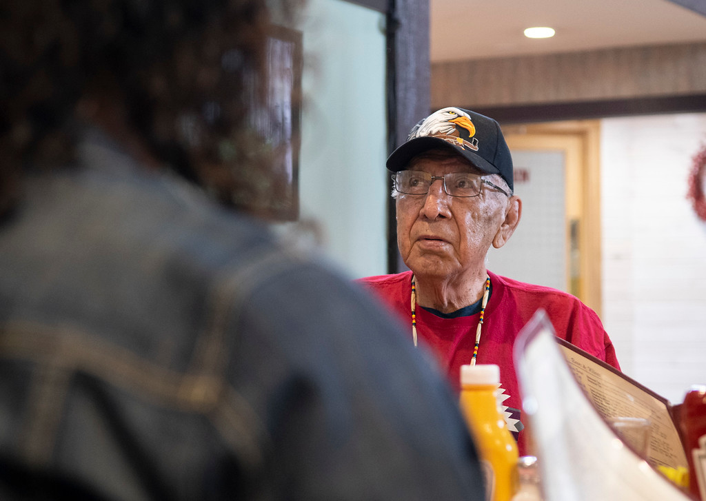. Nelson White orders food at lunch following a spiritual ceremony at Mary�s Lake Lodge which he led.  (Photo by Tyler Pialet/Trail-Gazette)