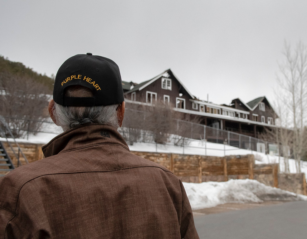 . Crawford White looks on to the burnt remains of Mary�s Lake Lodge.  (Photo by Tyler Pialet/Trail-Gazette)