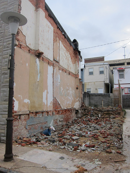 Vacant lot and demolition debris on alley corner