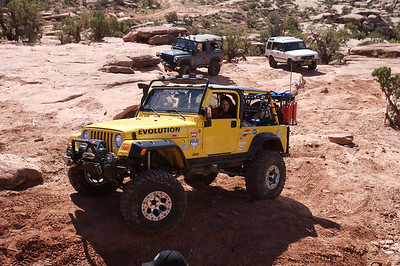 even Alex's heavily modified Jeep and professional driver needed to winch up this obstacle.