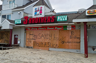 """""""Sandy Pizza Belmar""""  BELMAR, NEW JERSEY/USA – OCTOBER 30: Damaged store fronts along Ocean Ave the day after Hurricane Sandy on October 30, 2012 in Belmar New Jersey"""