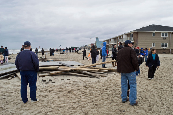 """Sandy Belmar People on Beach""<br /> <br /> <br /> BELMAR, NEW JERSEY/USA – OCTOBER 30: People survey damage along the beach the day after Hurricane Sandy on October 30, 2012 in Belmar New Jersey."