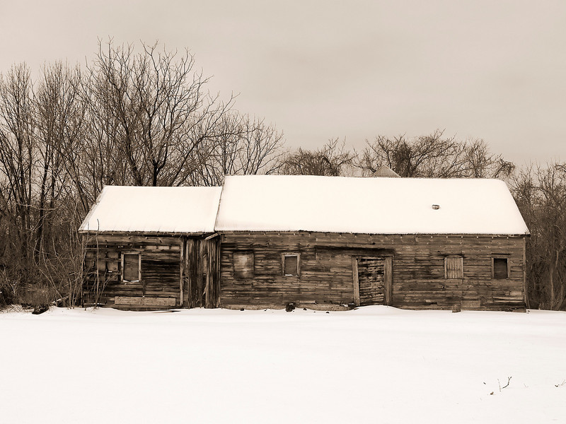 """""""Sepia Cabin""""<br /> <br /> An old cabin in Winter with snow and a sepia toned effect."""