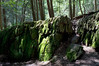"""Rock Formation in Woods""  Large rock formations covered in green moss in Stokes State Forest in North West New Jersey."