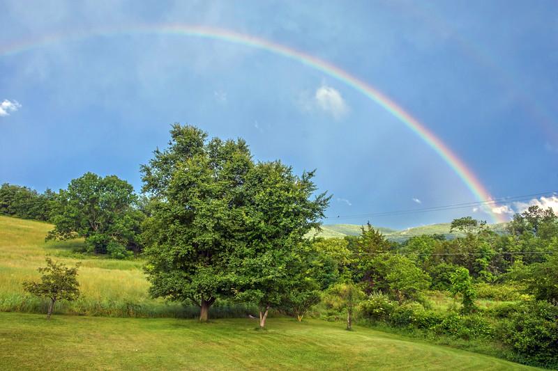 Rainbow Over Countryside