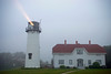 """Chatham Lighthouse"" The Chatham Lighthouse on Cape Cod with light beam cutting through the evening fog."