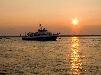 A fishing boat at sunset near Long Beach Island along the Jersey Shore.