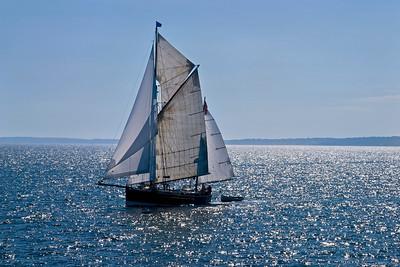 """Sunshine Sailboat"" A beautiful sailing vessel off the coast of Martha's Vinyard off Massachusetts."