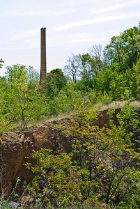 """"""" Smokestack And Cliff"""" A Snake Hillside view of the old smokestack still standing and the rugged terrain of the hill."""