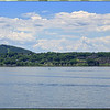 Hudson River looking west towards Kingston NY. Snake Hill to the left hosting cell towers. River View Condos to the right emitting reflections from objects on top of buildings.