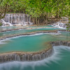 Terraced pools at Kuang Si waterfall in Laos