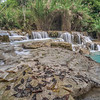 Detail of rock ledges at Kuang Si waterfall in Laos